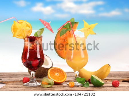 Cocktails on the beach - stock photo