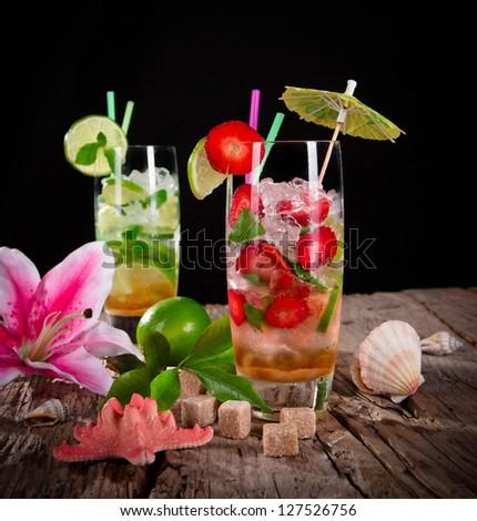 Cocktails over black background - stock photo