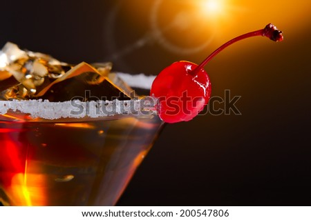 cocktails with cherry and ice on dark background - stock photo
