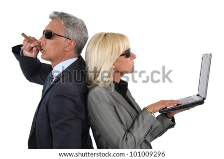 Cocky businessman and businesswoman - stock photo