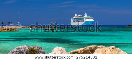 """COCO-CAY ISLAND, BAHAMAS - APRIL 2, 2014: """"Grandeur of the Seas"""" cruise ship was tendered next to the shore. Over 2,500 passengers went out to visit exotic private island. - stock photo"""