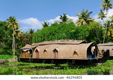 Coco trees reflection and beautifoull house boat at back waters of Kerala, India - stock photo