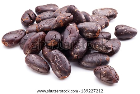 Cocoa beans on a white background. - stock photo