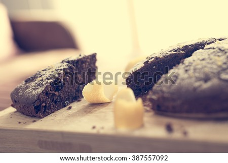 Cocoa cake with grated lemon and powdered sugar - vintage photo filter - stock photo