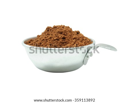 Cocoa powder in measuring cup isolated on white background - stock photo