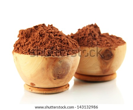 Cocoa powder in wooden bowls, isolated on white - stock photo