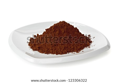 Cocoa powder pile in plate on white background - stock photo