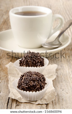 cocoa praline with chocolate sprinkle and a cup of coffee - stock photo