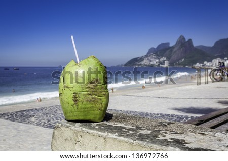 Coconut against Ipanema Beach, Rio de Janeiro, Brazil - stock photo