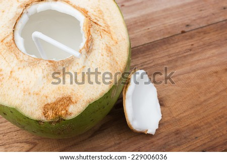 Coconut and juice on wood background. Healthy drink.