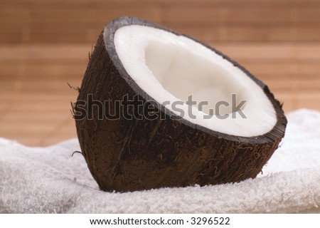 coconut, bamboo and white towel. exotic, tropical scene. beautyfarm - stock photo