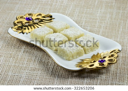 Coconut Barfi - Khoa aur Nariyal ki Barfi (an Indian sweet dish made with concentrated whole milk and grated coconut). - stock photo