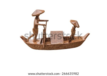 Coconut boat with the man merely wind that is handmade from VietNam - stock photo