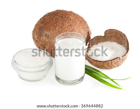 Coconut, coconut milk and shavings isolated on white - stock photo