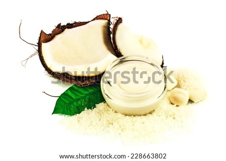 Coconut cocos with cream and green leaf isolated on white background - stock photo