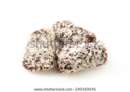 Coconut date bars on a white background - stock photo