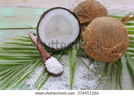 Coconut flakes with coconut on palm leaves  - stock photo