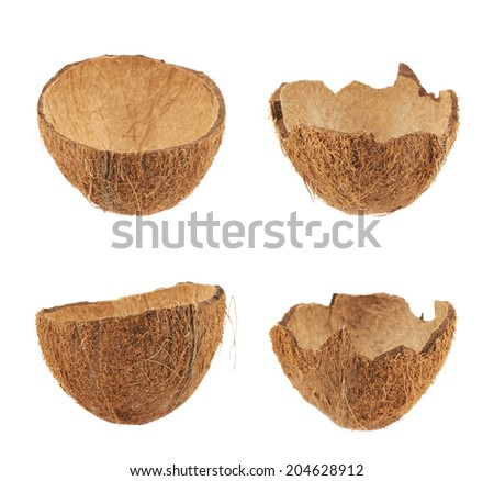 Coconut fruit shell cut in half isolated over the white background, set of four halves - stock photo