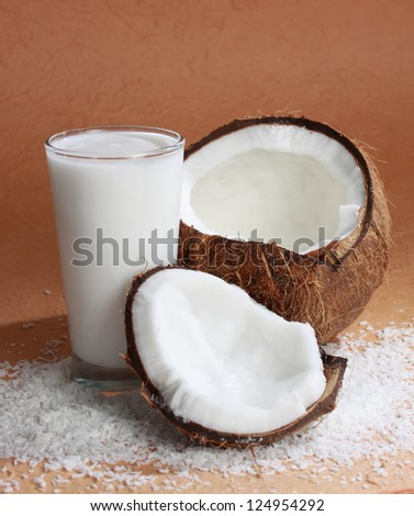 coconut fruit with a glass filled with coco milk