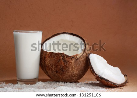 coconut fruit with a glass filled with coco milk - stock photo