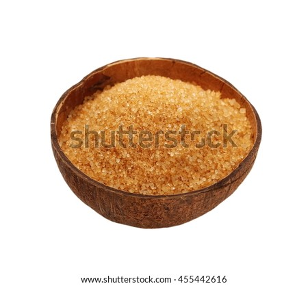 Coconut half and coconut sugar isolated on white background