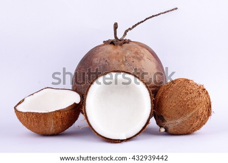coconut half clipping path for coconut milk and brown coconut shell  on white background healthy fruit food isolated - stock photo