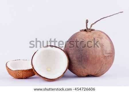 coconut half clipping path for coconut milk and brown ripe  coconut  on white background healthy fruit food isolated  - stock photo