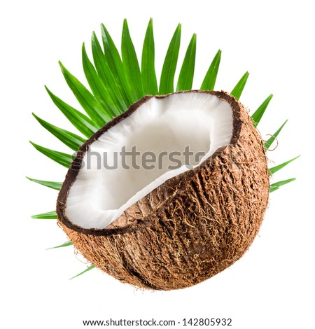 Coconut half with leaf on a white background - stock photo