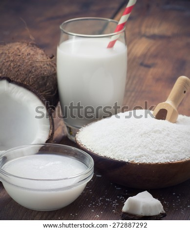 coconut oil, grounded coconut flakes and coconut milk - stock photo