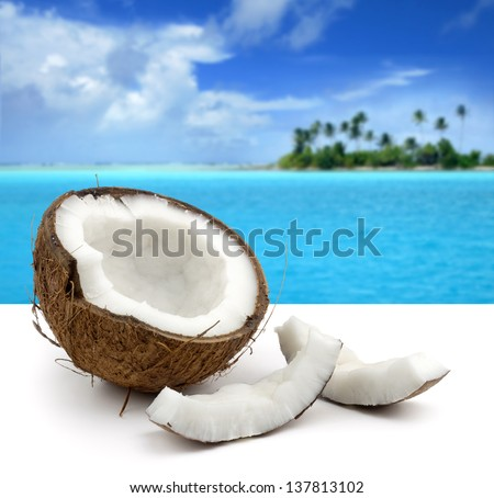 coconut on white background and beautiful seascape - stock photo