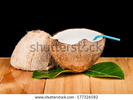 coconut on wood - stock photo