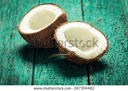 Coconut on wooden table.Vintage filter. Organic healthy food concept.Beauty and SPA concept. - stock photo