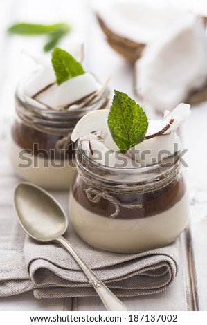 Coconut Panna Cotta on white table - stock photo