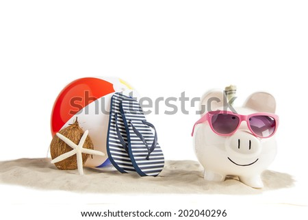Coconut Piggy bank in foreground with Colorful Beach Ball, Star Fish and Sandals, Flip Flops in Beach Sand in background on isolated white - stock photo