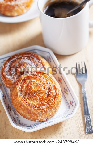 coconut snail pastry for breakfast - stock photo