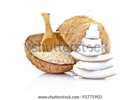 coconut spa salt in coconut shell with wooden spoon - stock photo