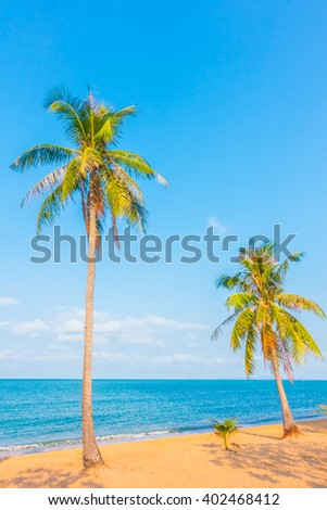 Coconut tree on the beautiful tropical beach and sea - Boost up color Processing