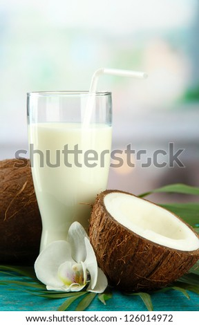 Coconut with glass of milk,  on blue wooden table