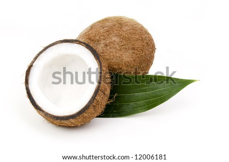 Coconuts with green leaf isolated on white background - stock photo