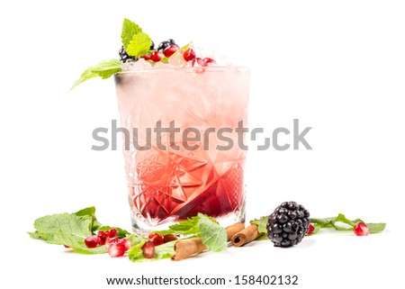 coctail with ice, berrys and leaf mint - stock photo