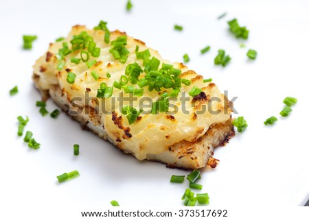 cod baked with mashed potatoes - stock photo