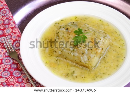 Cod fillet in a green sauce