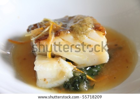 Cod fillet with vegetables and  sauce,State run hotel Santa Catalina castle Andalusia Spain - stock photo