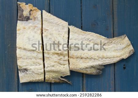 cod fish on blue background - stock photo