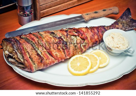 Cod fish wrapped in bacon - stock photo