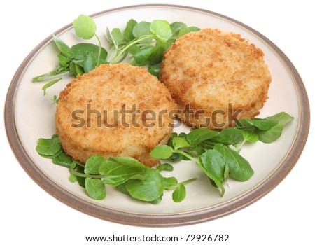 Cod fishcakes with watercress. - stock photo