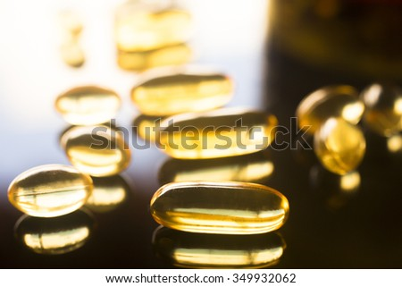 Cod liver fish oil omega 3, 6 and 9 capsules health food supplements. - stock photo