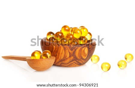 cod liver oil in the wooden bowl. - stock photo