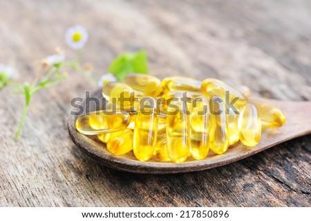 cod liver oil omega 3 gel capsules. - stock photo