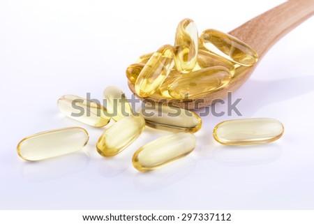 Cod liver oil omega 3 gel capsules on white background - stock photo